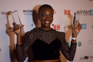Constance with two awards
